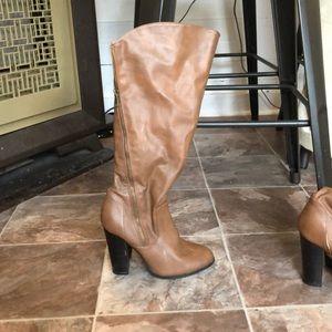 Below knee heel boots